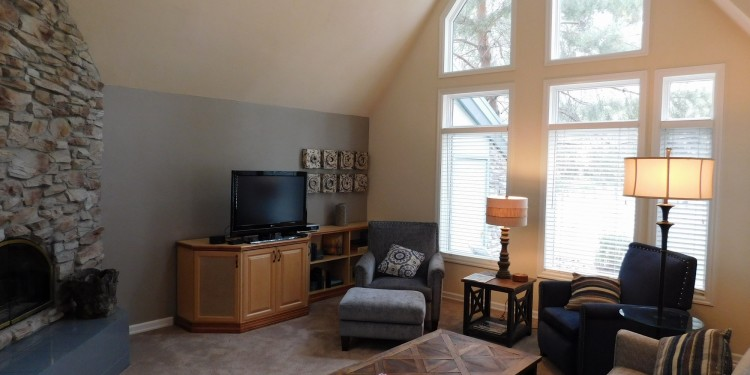 Big windows and cozy couches at StoneRidge Townhomes #19