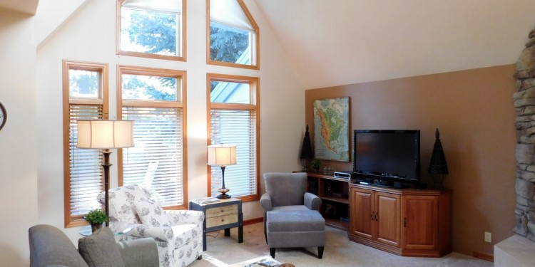 tv living area and tall windows in StoneRidge Townhomes home #11