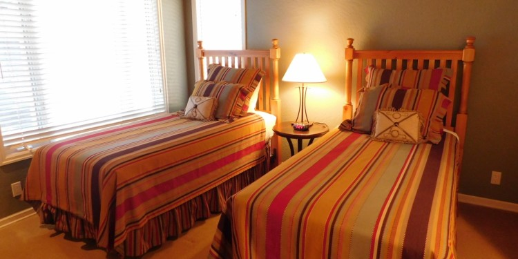 Twin beds in home #25 at StoneRidge Townhomes
